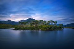 Pine Trees Island in the Derryclare Lake at sunset. Galway county, Ireland. Long exposure royalty free stock photography