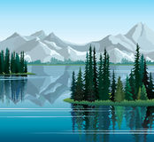 Pine trees reflected in water with mountains Royalty Free Stock Photography