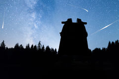 Pine trees silhouette Milky Way observatory Falling stars Royalty Free Stock Images