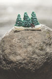 Pine trees during the winter. Miniature figures of pine trees during the winter Stock Photo