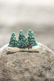 Pine trees during the winter. Miniature figures of pine trees during the winter Stock Photos