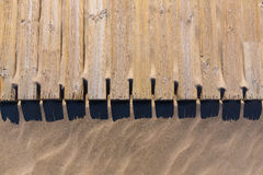 Pine wood deck weathered in beach sand texture Stock Photos