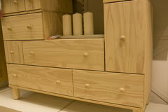 Pine wood dresser in furniture store. Elegant dresser in a store Royalty Free Stock Image