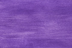 Pine wood surface painted with violet acrylic paint Royalty Free Stock Photography