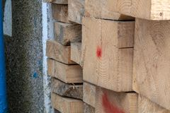 Pine wood timber stack of natural rough wooden boards on building site. Industrial timber building materials for carpentry, building close-up stock image