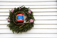 Patriotic Wreath with Toy Drum and US Flags Stock Photo