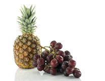 Pineaple and red grapes Royalty Free Stock Photos