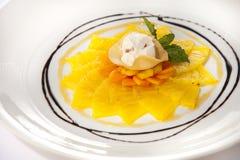 Pineapple. Carpaccio with papaya and vanilla ice cream Stock Photography