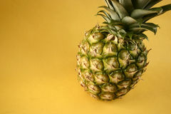 Pineapple. And grapes on yellow background royalty free stock images