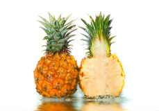 Pineapple. With poured water. Isolation on white stock image