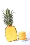 Pineapple. (Ananas comosus, Ananas sativus) - fresh, halved fruit and slices from the can Stock Photo
