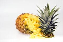 Pineapple. Cut open and contents diced. White background. Copy Space stock image