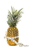 Pineapple. And measured tape which circle is reduced by a clothespin.Great diet concept royalty free stock photos