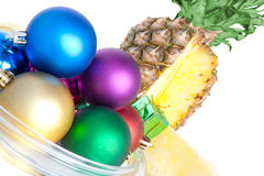 Pineapple. Fresh pineapple decorated christmas toys on a white background Stock Images