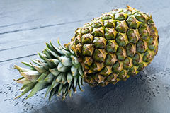 Pineapple or ananas. On stone table closeup view Royalty Free Stock Image