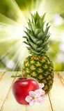 Pineapple and apple closeup Royalty Free Stock Images