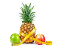 Pineapple and apple Royalty Free Stock Image