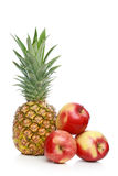 Pineapple and apples Stock Image
