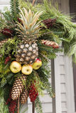 Pineapple, pinecone and apple wreath Royalty Free Stock Photos