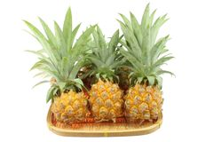 Pineapple in bamboo for sale Royalty Free Stock Photography