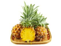 Pineapple in bamboo for sale Stock Photos