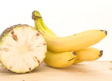 Pineapple and bananas Stock Images