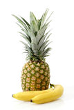 Pineapple with bananas Stock Photography