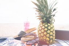 Pineapple on beach blanket