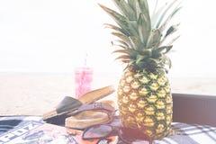 Pineapple on beach blanket Stock Image