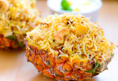 Pineapple Biryani. Biryani, biriani, or beriani is a set of rice-based foods made with spices, rice usually basmati and meat, fish, eggs,chicken or vegetables stock image
