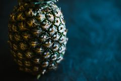 Pineapple on a black matte cement background royalty free stock photography