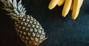 Pineapple on a black matte cement background stock images