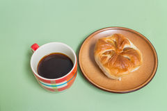 pineapple bread  on the brown dish with black coffee Royalty Free Stock Images