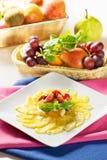Pineapple Carpaccio. With fruit salad Stock Photo
