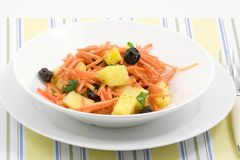 Pineapple carrot salad. Shredded carrots, pineapple chunks, raisens mixed together for a refreshing salad Royalty Free Stock Image