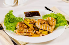 Pineapple Cashew Chicken Dish Served in Restaurant. High Angle of Pineapple Cashew Chicken Dish on Plate in Restaurant Royalty Free Stock Image