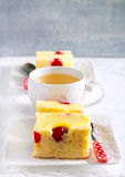 Pineapple and cherry cake, sliced. And cup of  tea Royalty Free Stock Photos