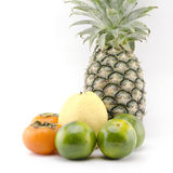 Pineapple chinese pear persimon and green orange  on whi Stock Photography