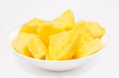 Pineapple chunks in the bowl isolated Stock Photography