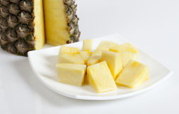 Pineapple chunks in the plate Royalty Free Stock Image