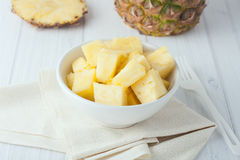 Pineapple chunks in white bowl Royalty Free Stock Photography