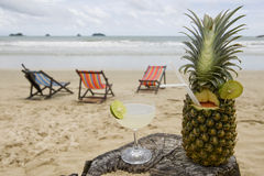 Pineapple, cocktail on the beach stock photography