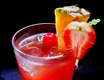 Pineapple  cocktail  with cherry and strawberry Royalty Free Stock Photo