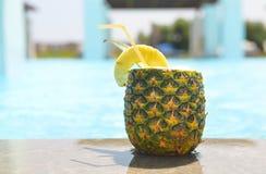 Pineapple cocktail near pool. Pina colada Royalty Free Stock Photo