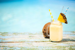 Pineapple cocktail near pool. Pina colada Stock Images