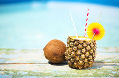 Pineapple cocktail near pool. Pina colada Stock Photography
