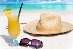 Pineapple cocktail and straw hat Stock Photos