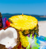 Pineapple and coconut on the beach Royalty Free Stock Photo