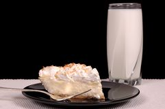 Pineapple coconut cream pie and milk. Pineapple coconut cream pie with toasted coconut and a glass of milk Royalty Free Stock Image