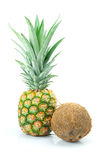 Pineapple and coconut isolated on white Stock Images
